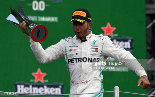 Mercedes' British driver Lewis Hamilton celebrates at the podium after winning the F1 Mexico Grand Prix at the Hermanos Rodriguez racetrack in Mexico...
