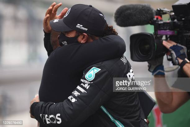 Mercedes' British driver Lewis Hamilton celebrates his victory with his father Anthony in the parc ferme after the Portuguese Formula One Grand Prix...