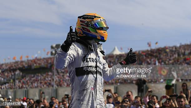 Mercedes' British driver Lewis Hamilton celebrates in the parc ferme at the Hungaroring circuit in Budapest on July 28 2013 during the Hungarian...