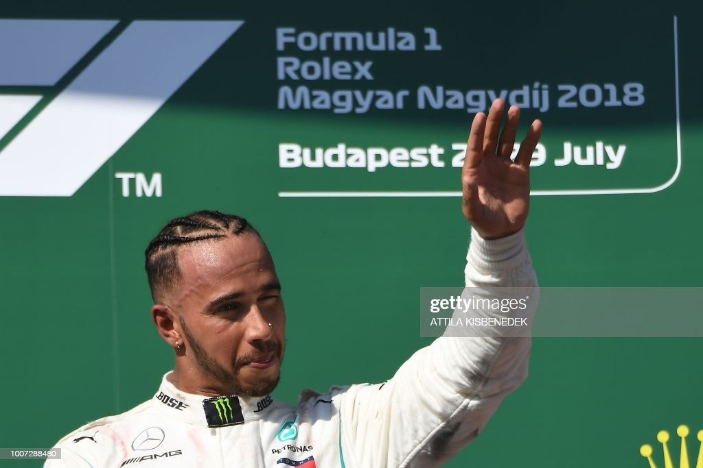 Mercedes' British driver Lewis Hamilton celebrates on the podium after winning the Formula One Hungarian Grand Prix at the Hungaroring circuit in Mogyorod near Budapest, Hungary, on July 29, 2018.