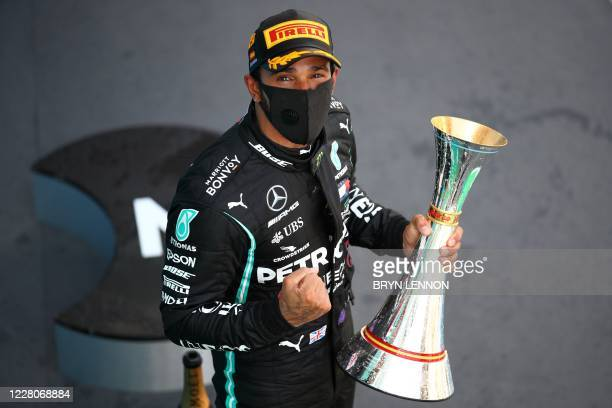 Mercedes' British driver Lewis Hamilton celebrates on the podium after the Spanish Formula One Grand Prix at the Circuit de Catalunya in Montmelo...