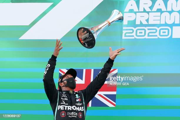 TOPSHOT Mercedes' British driver Lewis Hamilton celebrates on the podium after the Spanish Formula One Grand Prix at the Circuit de Catalunya in...