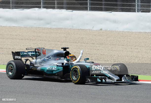 Mercedes' British driver Lewis Hamilton celebrates winning at the Circuit de Catalunya on May 14 2017 in Montmelo on the outskirts of Barcelona...