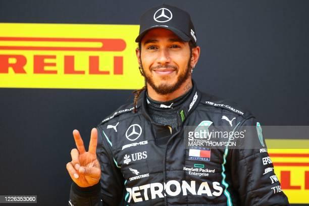 Mercedes' British driver Lewis Hamilton celebrates winning the Formula One Styrian Grand Prix race on July 12, 2020 in Spielberg, Austria.