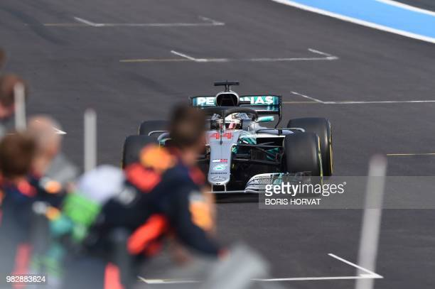 Mercedes' British driver Lewis Hamilton celebrates winning the Formula One Grand Prix de France at the Circuit Paul Ricard in Le Castellet southern...