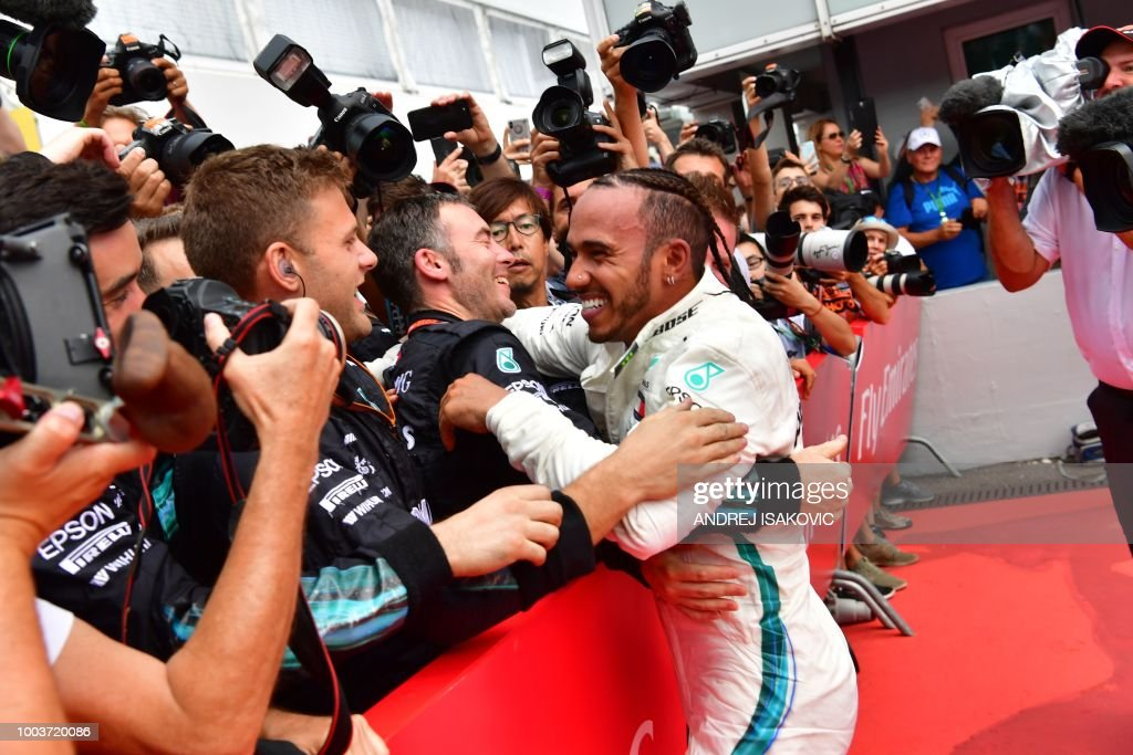 TOPSHOT - Mercedes' British driver Lewis Hamilton celebrates with his staff after winning the German Formula One Grand Prix at the Hockenheim racing circuit on July 22, 2018 in Hockenheim, southern Germany.