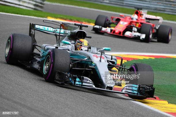 TOPSHOT Mercedes' British driver Lewis Hamilton competes to win ahead of Ferrari's German driver Sebastian Vettel during the Belgian Formula One...
