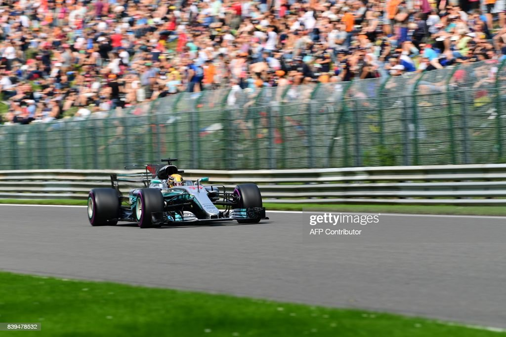 TOPSHOT - Mercedes' British driver Lewis Hamilton competes to win his 68th pole position equalling the record by Formula One driver Michael Schumacher as he drives during the qualifying session at the Spa-Francorchamps circuit in Spa on August 26, 2017 ahead of the Belgian Formula One Grand Prix. / AFP PHOTO / Emmanuel DUNAND