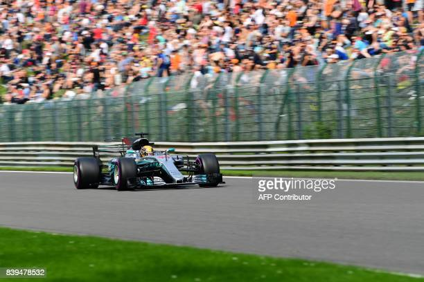TOPSHOT Mercedes' British driver Lewis Hamilton competes to win his 68th pole position equalling the record by Formula One driver Michael Schumacher...