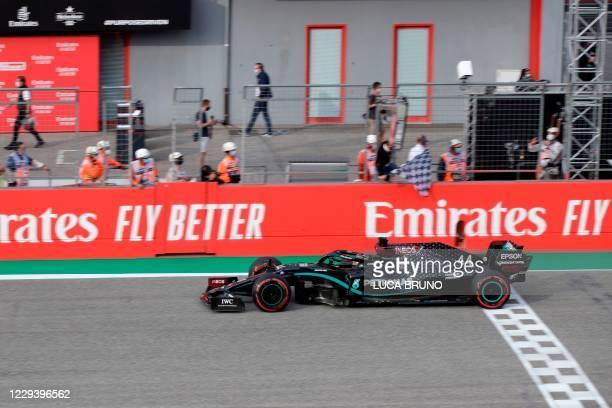 Mercedes' British driver Lewis Hamilton crosses the finish line to win the Formula One Emilia Romagna Grand Prix at the Autodromo Internazionale Enzo...