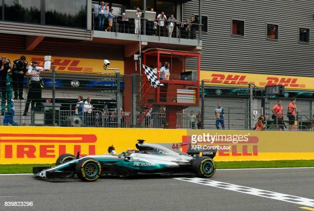 TOPSHOT Mercedes' British driver Lewis Hamilton crosses the finish line to win the Belgian Formula One Grand Prix at the SpaFrancorchamps circuit in...