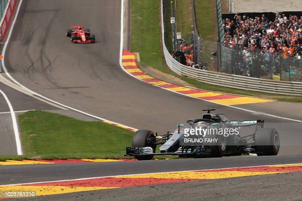 Mercedes' British driver Lewis Hamilton drives ahead of Ferrari's German driver Sebastian Vettel during the first lap of the Belgian Formula One...