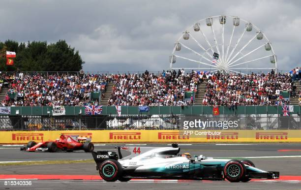TOPSHOT Mercedes' British driver Lewis Hamilton drives ahead of Ferrari's Finnish driver Kimi Raikkonen during the British Formula One Grand Prix at...