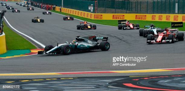 Mercedes' British driver Lewis Hamilton drives ahead of Ferrari's German driver Sebastian Vettel and Mercedes' Finnish driver Valtteri Bottas during...