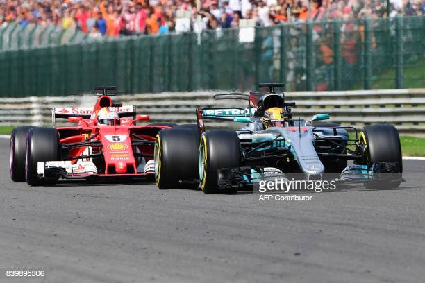 Mercedes' British driver Lewis Hamilton drives ahead of Ferrari's German driver Sebastian Vettel during the Belgian Formula One Grand Prix at the...