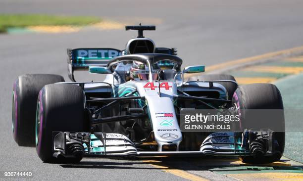 Mercedes' British driver Lewis Hamilton drives around the Albert Park circuit during the first Formula One practice session in Melbourne on March 23...