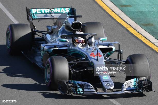 Mercedes' British driver Lewis Hamilton drives around the Albert Park circuit during the second Formula One practice session in Melbourne on March 23...