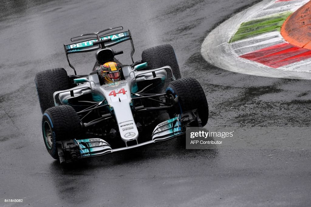 Mercedes' British driver Lewis Hamilton drives as it rains during the qualifying session at the Autodromo Nazionale circuit in Monza on September 2, 2017 ahead of the Italian Formula One Grand Prix. The qualifying session in Monza has been delayed because of bad weather conditions. /