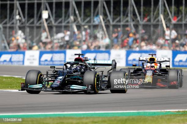 Mercedes' British driver Lewis Hamilton drives at Becketts Corner during the practice 1 session of the Formula One British Grand Prix at the...