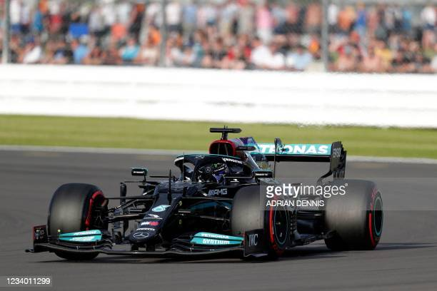 Mercedes' British driver Lewis Hamilton drives at Luffield Corner during the practice 1 session of the Formula One British Grand Prix at the...