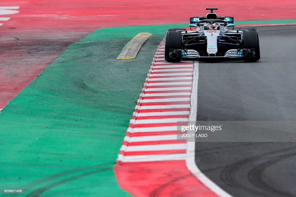 TOPSHOT - Mercedes' British driver Lewis Hamilton drives at the Circuit de Catalunya on March 1, 2018 in Montmelo on the outskirts of Barcelona during the fourth day of the first week of tests for the Formula One Grand Prix season. / AFP PHOTO / Josep LAGO