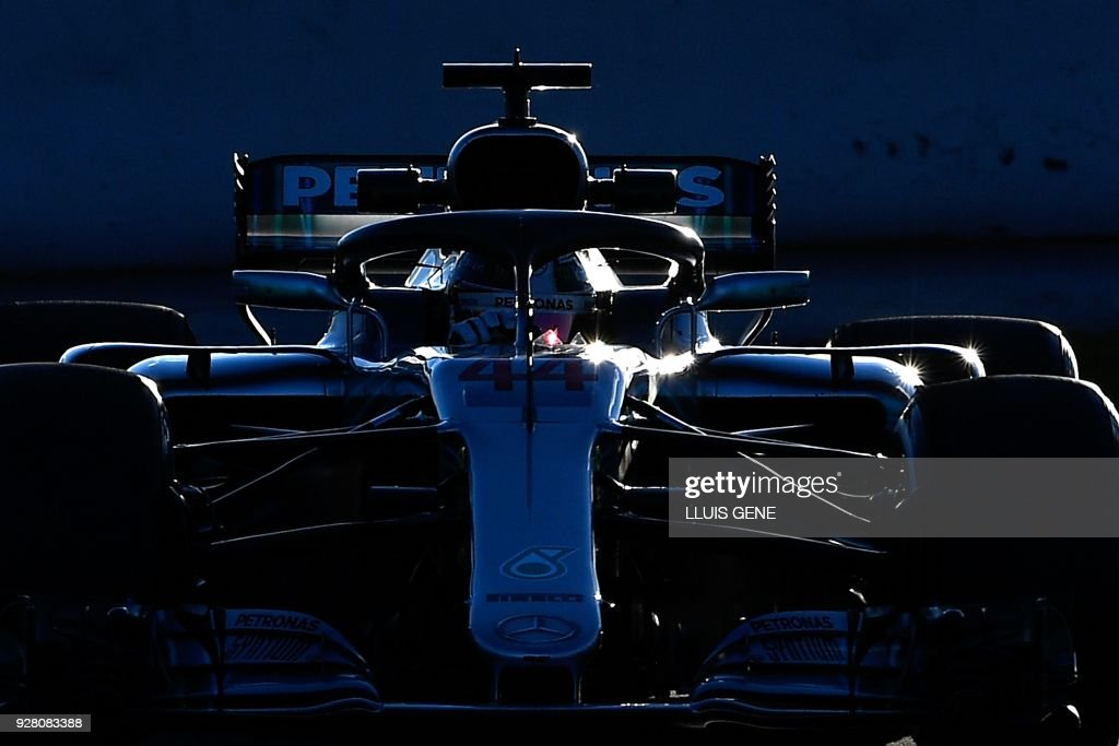 TOPSHOT - Mercedes' British driver Lewis Hamilton drives at the Circuit de Catalunya on March 6, 2018 in Montmelo on the outskirts of Barcelona during the first day of the second week of tests for the Formula One Grand Prix season. /