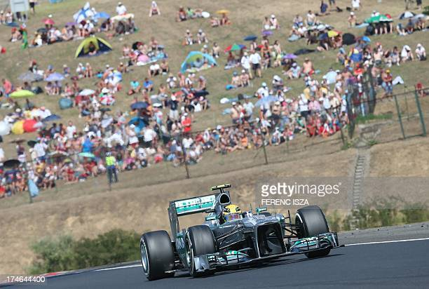 Mercedes' British driver Lewis Hamilton drives at the Hungaroring circuit in Budapest on July 28 2013 during the Hungarian Formula One Grand Prix AFP...