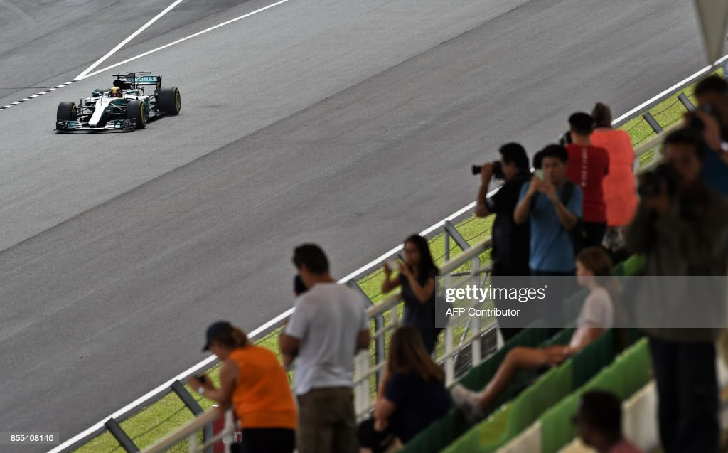 Mercedes' British driver Lewis Hamilton drives during his second practice session of the Formula One Malaysia Grand Prix at the Sepang circuit near Kuala Lumpur on September 29, 2017. /