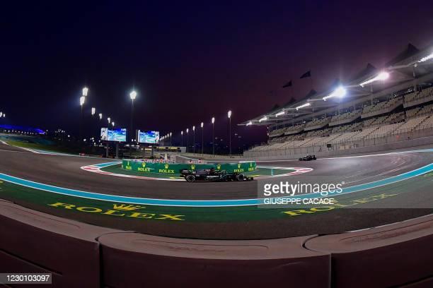 Mercedes' British driver Lewis Hamilton drives during the Abu Dhabi Formula One Grand Prix at the Yas Marina Circuit in the Emirati city of Abu Dhabi...