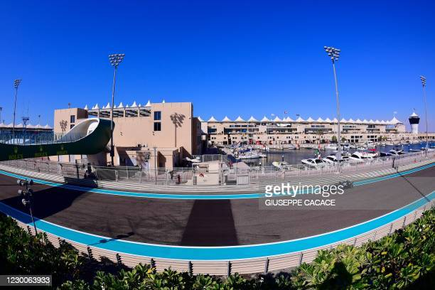 Mercedes' British driver Lewis Hamilton drives during the first practice session ahead of the Abu Dhabi Formula One Grand Prix at the Yas Marina...
