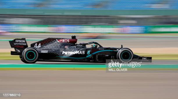 Mercedes' British driver Lewis Hamilton drives during the Formula One British Grand Prix at the Silverstone motor racing circuit in Silverstone,...