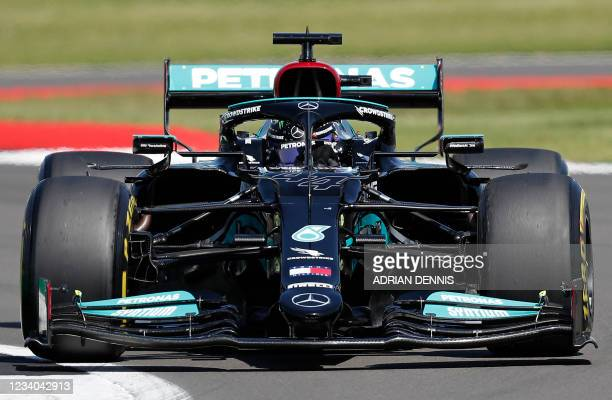 Mercedes' British driver Lewis Hamilton drives during the Formula One British Grand Prix motor race at Silverstone motor racing circuit in...