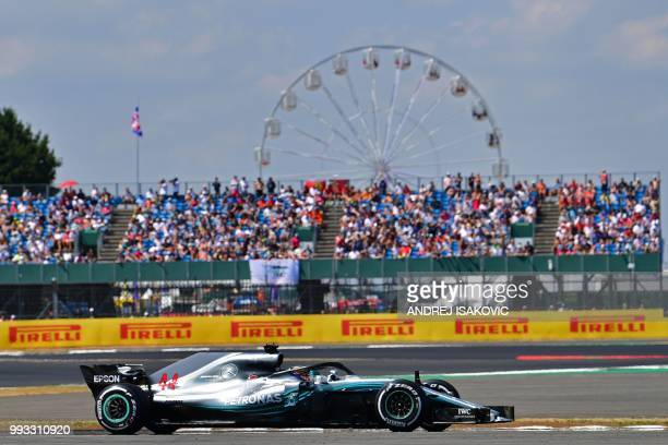 Mercedes' British driver Lewis Hamilton drives during the qualifying session at Silverstone motor racing circuit in Silverstone central England on...