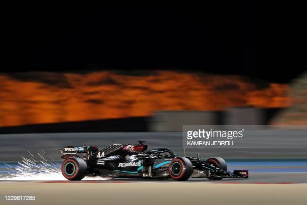 Mercedes' British driver Lewis Hamilton drives during the second practice session ahead of the Bahrain Formula One Grand Prix at the Bahrain...