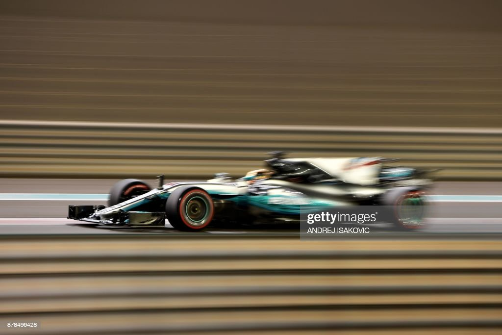 Mercedes' British driver Lewis Hamilton drives during the second practice session ahead of the Abu Dhabi Formula One Grand Prix at the Yas Marina circuit on November 24, 2017. / AFP PHOTO / Andrej ISAKOVIC