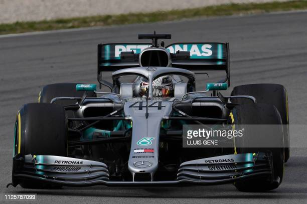 Mercedes' British driver Lewis Hamilton drives during the tests for the new Formula One Grand Prix season at the Circuit de Catalunya in Montmelo in...