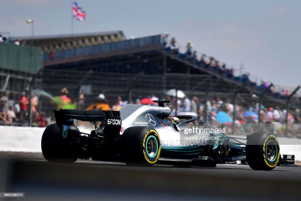 TOPSHOT - Mercedes' British driver Lewis Hamilton drives during the third practice session at Silverstone motor racing circuit in Silverstone, central England, on July 7, 2018 ahead of the British Formula One Grand Prix.