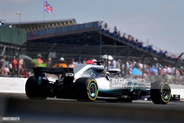 TOPSHOT Mercedes' British driver Lewis Hamilton drives during the third practice session at Silverstone motor racing circuit in Silverstone central...