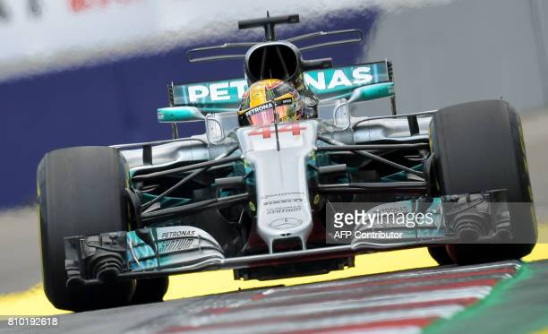 Mercedes' British driver Lewis Hamilton drives his car during the first practice session of the Formula One Austria Grand Prix at the Red Bull Ring...