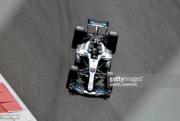 TOPSHOT Mercedes British driver Lewis Hamilton drives his car during the first practice session ahead of the Abu Dhabi Formula One Grand Prix at the...