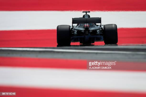 TOPSHOT Mercedes' British driver Lewis Hamilton drives his car during the third practice session ahead of the Austrian Formula One Grand Prix in...