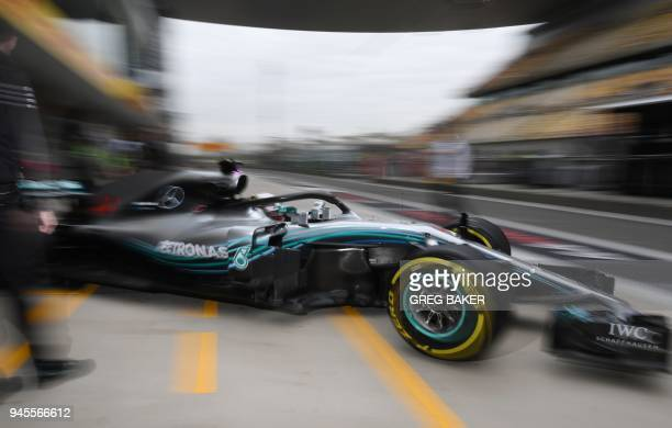 TOPSHOT Mercedes' British driver Lewis Hamilton drives in the pit lane during practice for the Formula One Chinese Grand Prix in Shanghai on April 13...