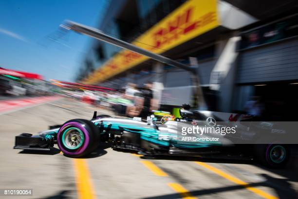 TOPSHOT Mercedes' British driver Lewis Hamilton drives out of the garage during the first practice session of the Formula One Austria Grand Prix at...