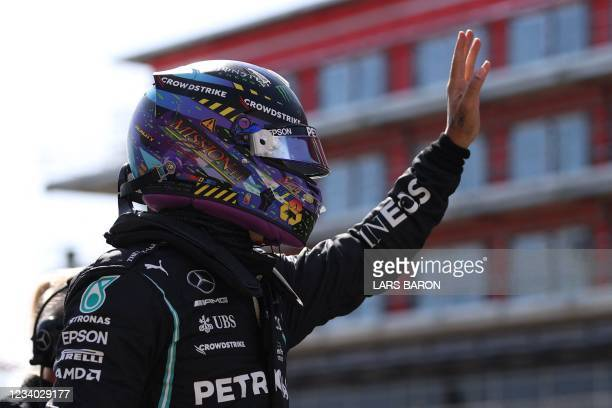 Mercedes' British driver Lewis Hamilton gestures ahead of the sprint session ahead of the Formula One British Grand Prix at the Silverstone motor...