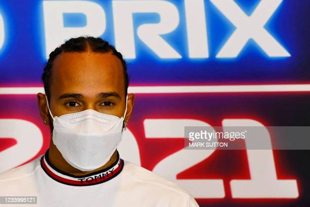 Mercedes' British driver Lewis Hamilton gestures during a press conference ahead of the Formula One British Grand Prix at the Silverstone motor...
