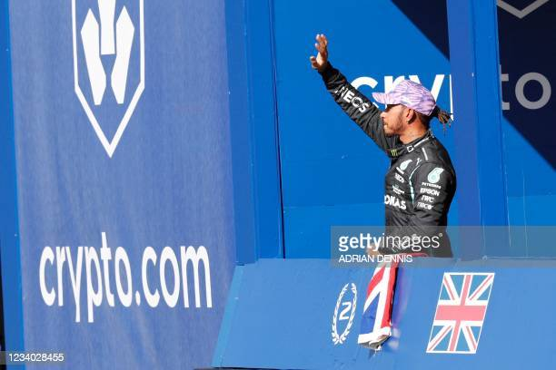 Mercedes' British driver Lewis Hamilton gestures to supporters after the sprint session of the Formula One British Grand Prix at Silverstone motor...