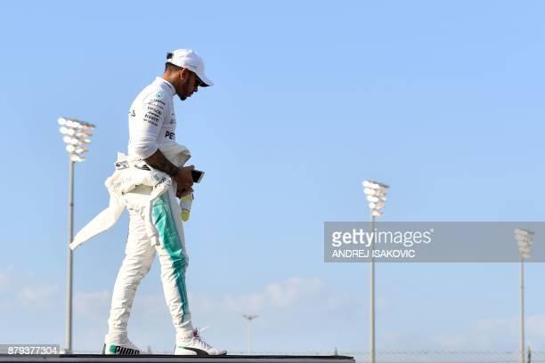 TOPSHOT Mercedes' British driver Lewis Hamilton is seen ahead of the Abu Dhabi Formula One Grand Prix at the Yas Marina circuit on November 26 2017 /...