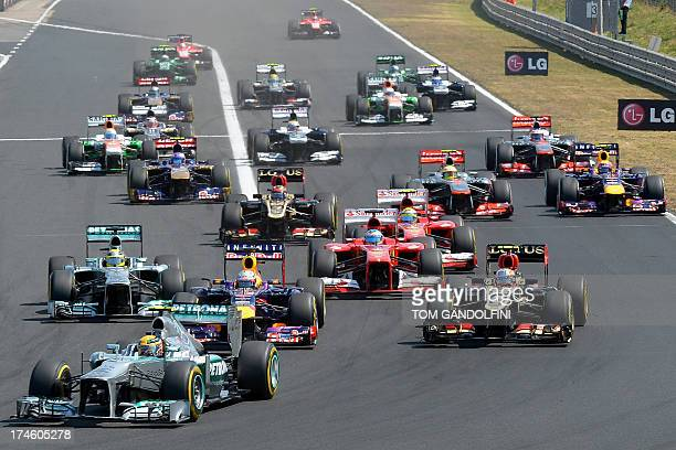 Mercedes' British driver Lewis Hamilton leads after the start at the Hungaroring circuit in Budapest on July 28 2013 during the Hungarian Formula One...