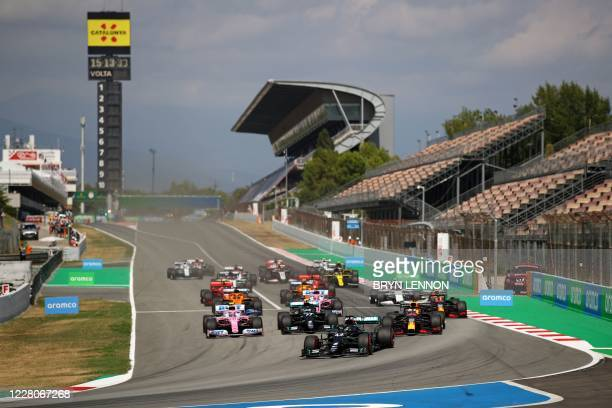 Mercedes' British driver Lewis Hamilton leads after the start of the Spanish Formula One Grand Prix at the Circuit de Catalunya in Montmelo near...