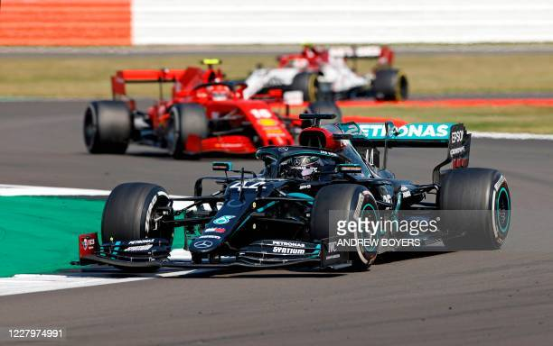 Mercedes' British driver Lewis Hamilton leads Ferrari's Monegasque driver Charles Leclerc through a corner during the F1 70th Anniversary Grand Prix...